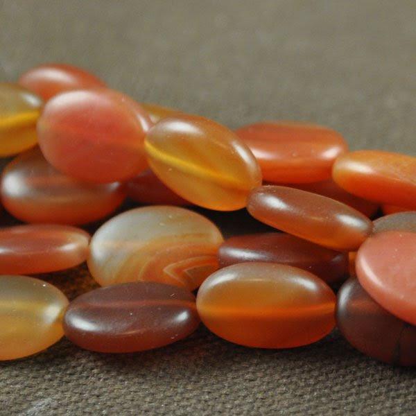 s33591 Stone Beads - 10 x 14 mm Oval - Matte Carnelian (strand)