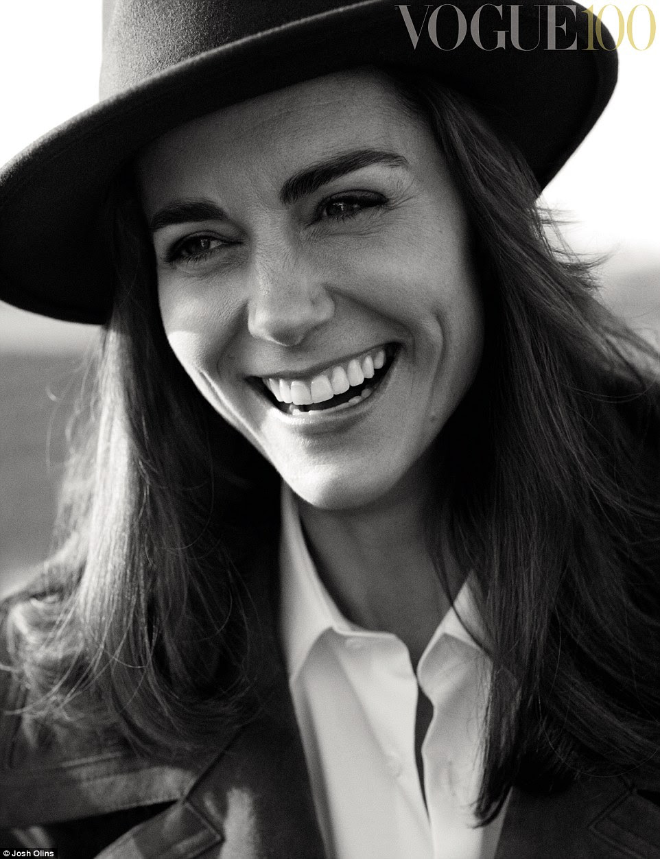 British Vogue and the National Portrait Gallery collaborated on the series of photographic portraits with HRH The Duchess of Cambridge. Here, Kate is wearing a black fedora hat from Beyond Retro and a charcoal brown double-breasted suede coat and white shirt, both from Burberry