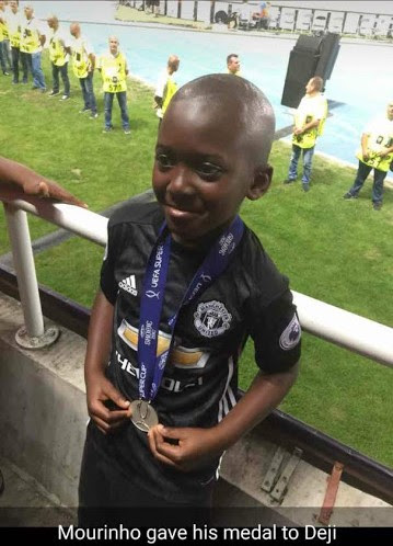 Image result for Man United manager gives his UEFA Super Cup medal to a Nigerian kid
