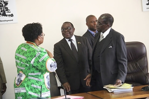 Republic of Zimbabwe Vice-President Joice Mujuru with Simon Khaya Moyo, ZANU-PF chair and President Robert Mugabe after a special party politburo meeting on February 14, 2014. by Pan-African News Wire File Photos