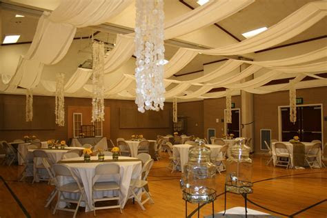 White basic tablecloths with burlap runners in an LDS