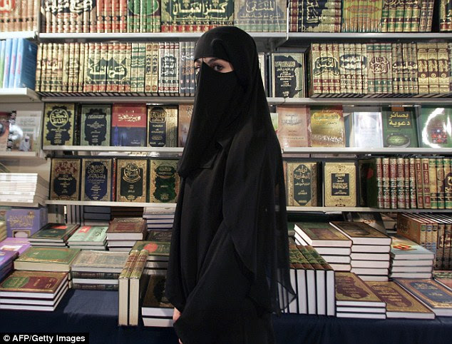 Christiane Ebrahimian was sacked from the psychiatric department of a hospital in Nanterre because patients complained about her refusal to remove hers (file photo of Muslim woman wearing burqa)