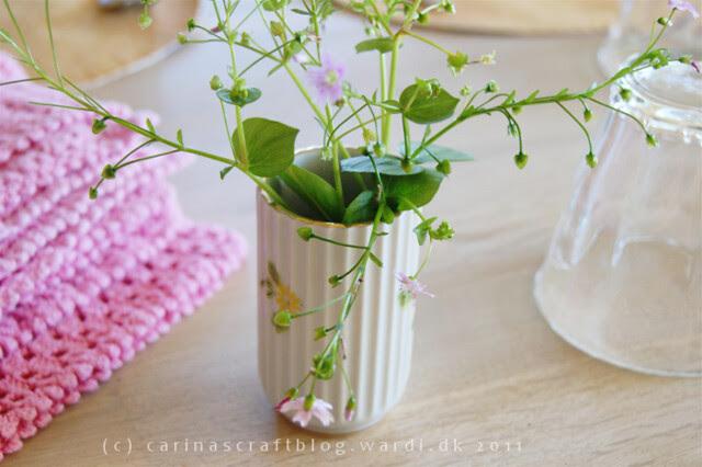 Pink flowers in small vintage vase