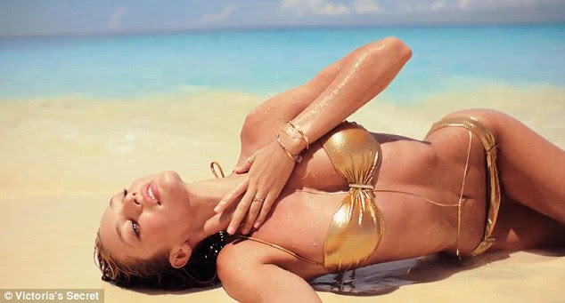 Hot stuff: Candice stars in the entire length of the gold bikini video
