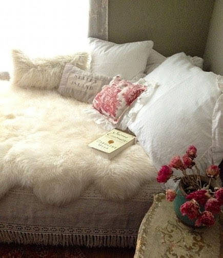 sheepskin rug on bed by Laura Venosa