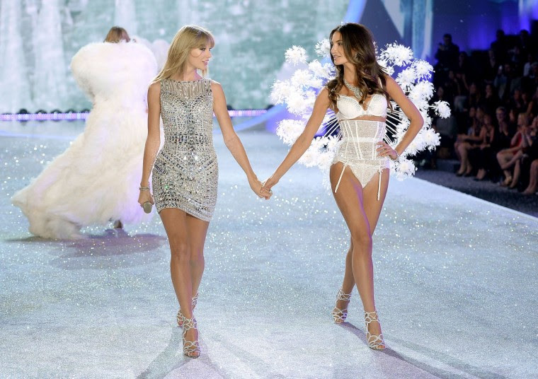 Singer Taylor Swift (L) performs and model Lily Aldridge walks the runway at the 2013 Victoria's Secret Fashion Show at Lexington Avenue Armory on November 13, 2013 in New York City. (Dimitrios Kambouris/Getty Images)