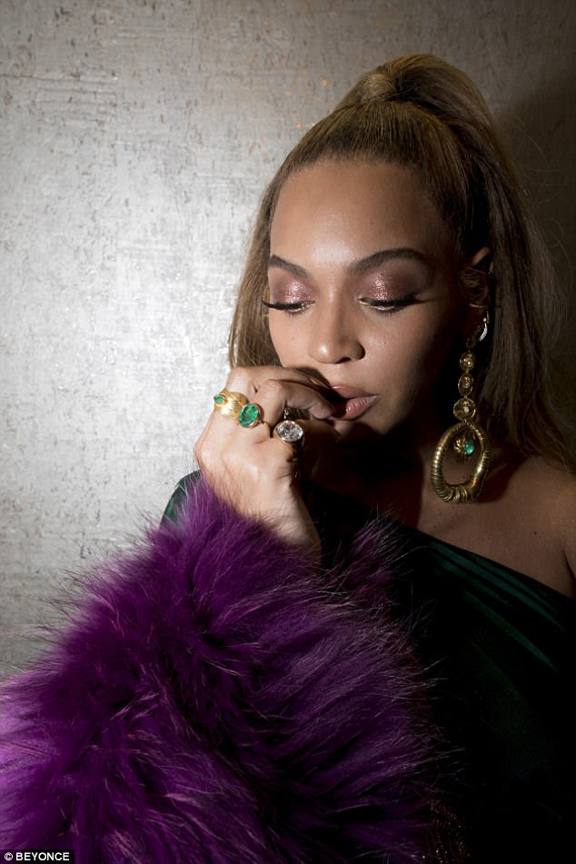 Bold: The mother of three rocked chunky gold and emerald earrings with coordinating rings