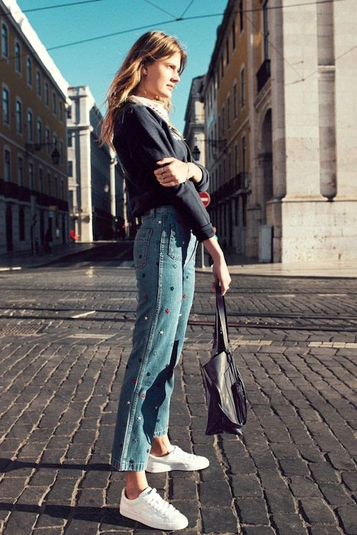 Le Fashion Blog Casual Fall Style Black Graphic Sweatshirt Embroidered Star Jeans Leather Tote Bag White Sneakers Via Madewell
