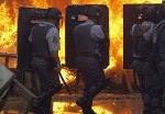 Ação da polícia no Pinheirinho em São José. (Foto: Roosevelt Cassio/Reuters)