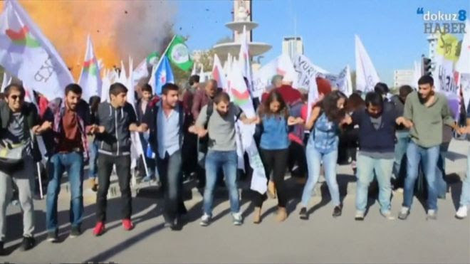 Grab from amateur video showing explosion in background, group of activists in foreground, Ankara (10 October 2015)