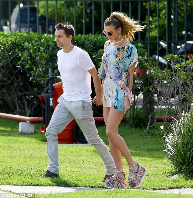 Happy-go-lucky: The 37-year-old Muse frontman - and ex-fiancé of Kate Hudson - proved to be in love again as he enjoyed the sights of Rio with the 25-year-old model-actress