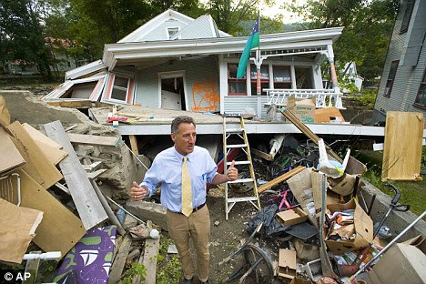 Destruction: Vermont Governor Peter Shumlin surveys the damage to Jon Graham's house in Rochester, Vermont