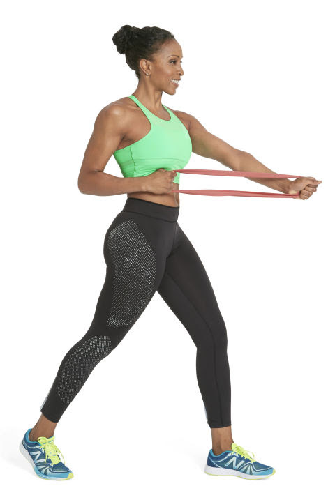 Works back, shoulders, and armsStand with feet staggered, left foot ahead of right, holding band with both hands extended just below chest level. Keeping left arm straight, pull right fist to rib cage (as shown). Straighten right arm to match left for one rep; do 12 reps. Switch sides and repeat. Engage your abs to ward off wobbling.