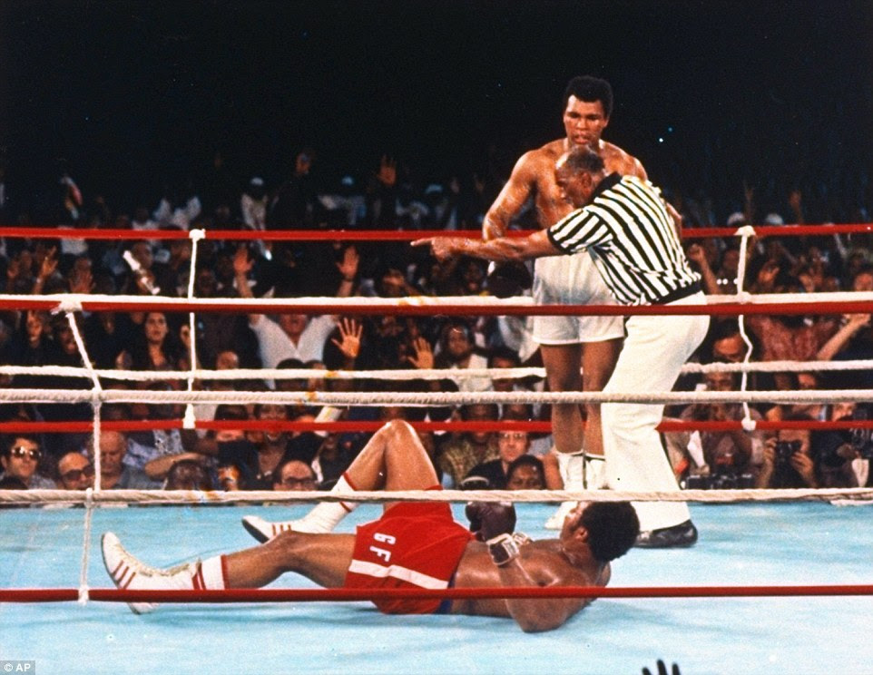 Referee Zack Clayton beckons Ali to the corner after he knocked down George Foreman in their 1974 fight