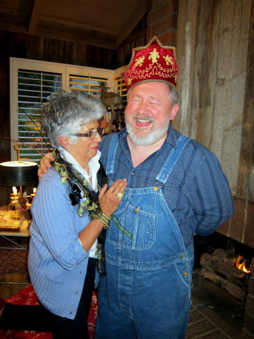 "Janis Foster brought lovely gifts for us all. Leslie received a lovely lace Mantilla and Paul this velvet crown. In my mind he shall forever be known as ""Popie."" As you see they were happy recipients. I behave better in front of Popie now that he has that magic hat."