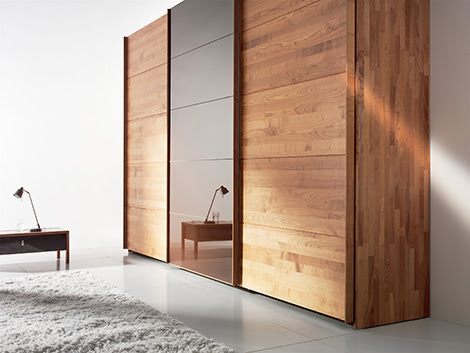 Solid Wood Wardrobe by Team 7 - Valore sliding door wardrobes are '