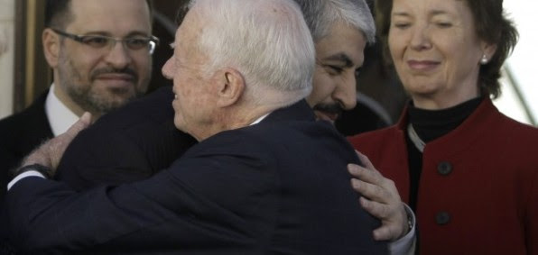 Former President Jimmy Carter embracing Hamas leader Khaled Mashaal