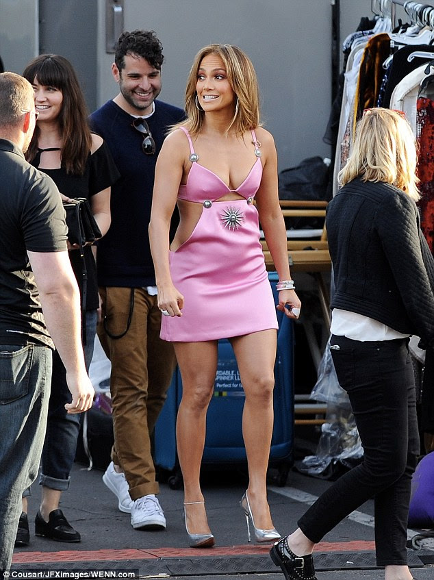 Pretty in pink: Jennifer Lopez, 46, put on a very busty display and showed offer her toned limbs in a racy pink mini dress on the set of American Idol on Thursday