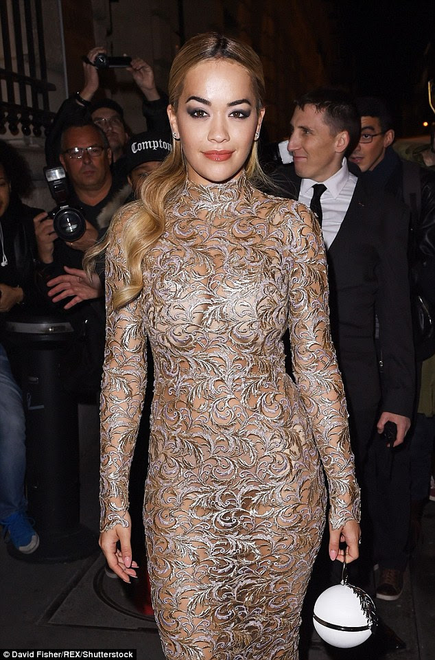 Wow thing: She turned heads when she wore a very racy orange cut-out dress to the Versace show in Paris on Sunday night and Rita kept things sexy the following day