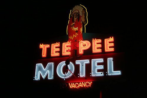 tee pee motel neon at night