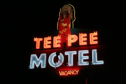 tee pee motel neon at night