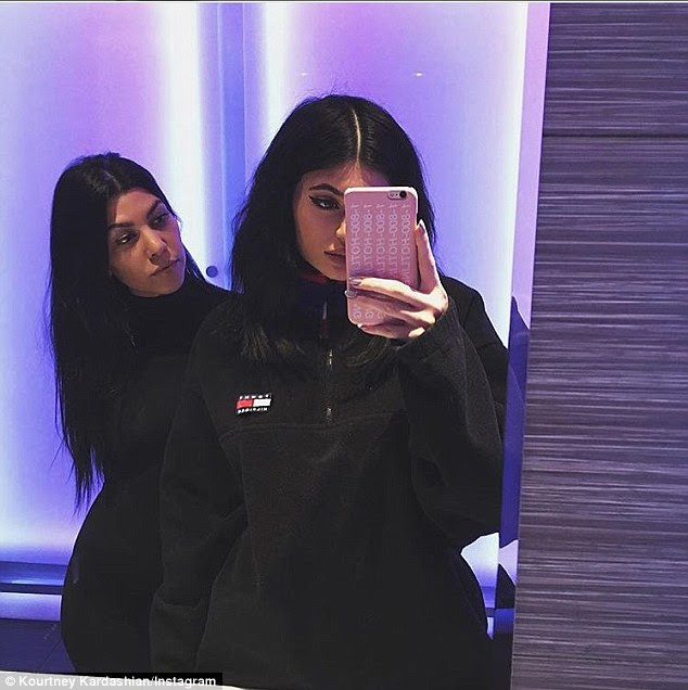 Snap happy: A second image showed Kourtney with Kylie, and was captioned simply 'SWISH'