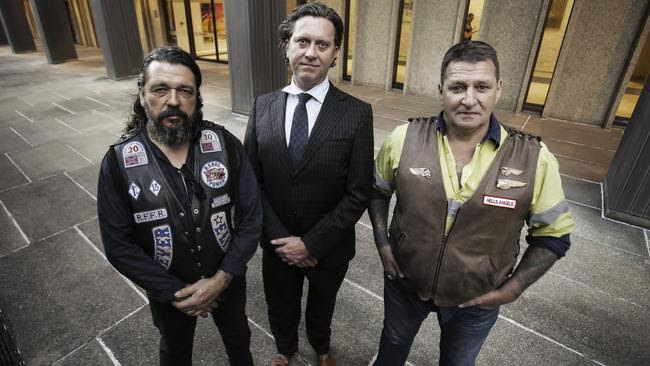 Lawyer Zeke Bentley (centre) with bikies Mick Kosenko (Rebels) and Terry McCormack (Hells Angels) after the announcement of report's findings on the VLAD laws. Picture: Mark Cranitch