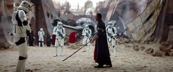 A blind figure (Donnie Yen) approaches a squad of Stormtroopers in ROGUE ONE: A STAR WARS STORY.
