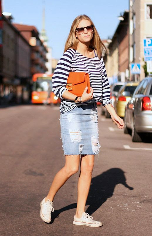 Le Fashion Blog 7 Ways To Style A Distressed Denim Skirt Blogger Tine Andrea Storlos Contrast Striped Long Sleeve Tee Tshirt Flat Top Sunglasses Orange Leather Box Clutch Converse Low Top Sneakers 7 photo Le-Fashion-Blog-7-Ways-To-Style-A-Distressed-Denim-Skirt-Tine-Andrea-Storlos-7.jpg