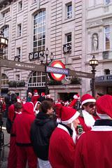 Santas at Piccadilly Circus Tube - Santacon 2011
