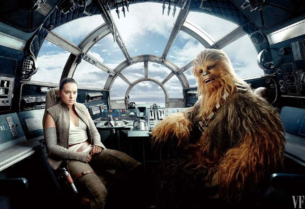 Daisy Ridley and Joonas Suotamo (as Chewbacca) pose inside the cockpit of the Millennium Falcon.