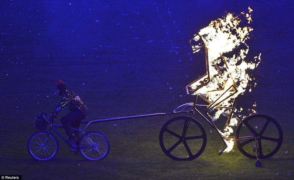 Flaming wheels! A fiery figure of a cyclist is towed into the stadium, fitting given Great Britain's triumph in cycling events at both the Olympic and Paralympic Games in London