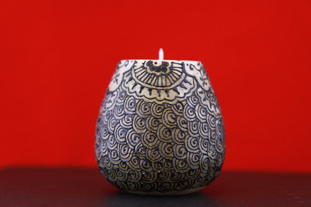 Intricate henna pattern on scented Candle