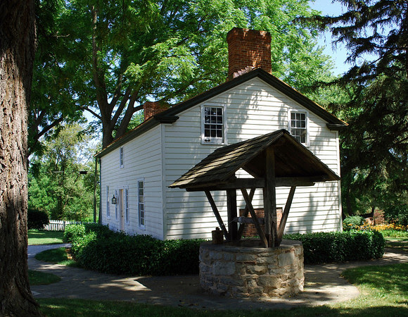 Side view and well of the Laura Secord Homestead.