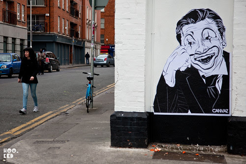 Irish street artist Canvaz paste up in Dublin