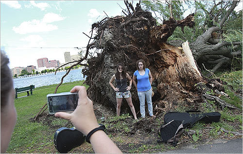 Berklee College students (left to right) Pam Autuori and Lydia Fischer had their photo taken in front of one of the trees.