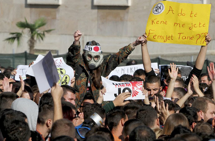 A man wearing a gas mask joins Albanian environmental activists as they take part in a protest in front of the Prime Ministerís office in Tirana on November 15, 2013, over the possibility of the Republic of Albania processing and destroying 1.000 tons of chemical weapons from Syria in its military facilities (AFP Photo / Gent Shkullaku)