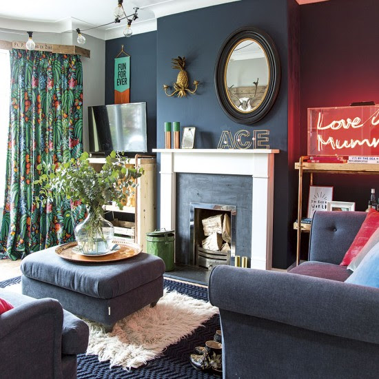 Modern living room with navy blue walls and furniture ...