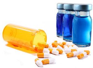 spilled bottle of pills and shot viles