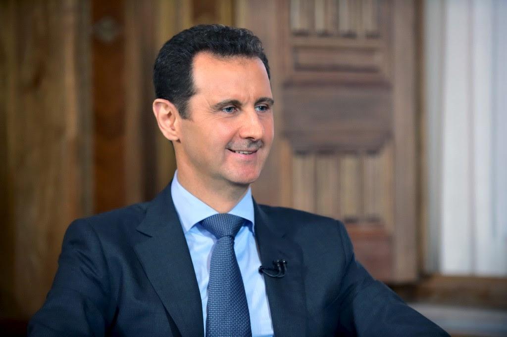Handout photo of Syrian President Bashar al-Assad by Syria's national news agency SANA via Reuters