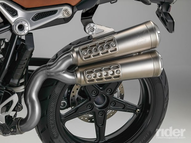 Smaller, premium Akrapovic mufflers with an even throatier song are standard on the Scrambler.