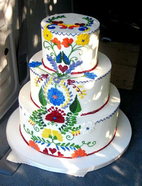 A Mexican themed wedding cake. Looks like the embroidery