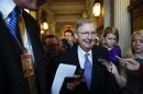 U.S. Senate Minority Leader McConnell speaks to reporters on his way to lunch at the U.S. Capitol in Washington