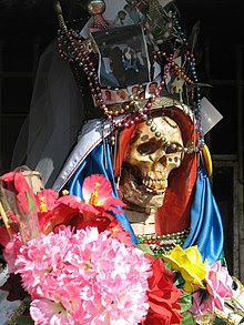 a typical Santa Muerte statue