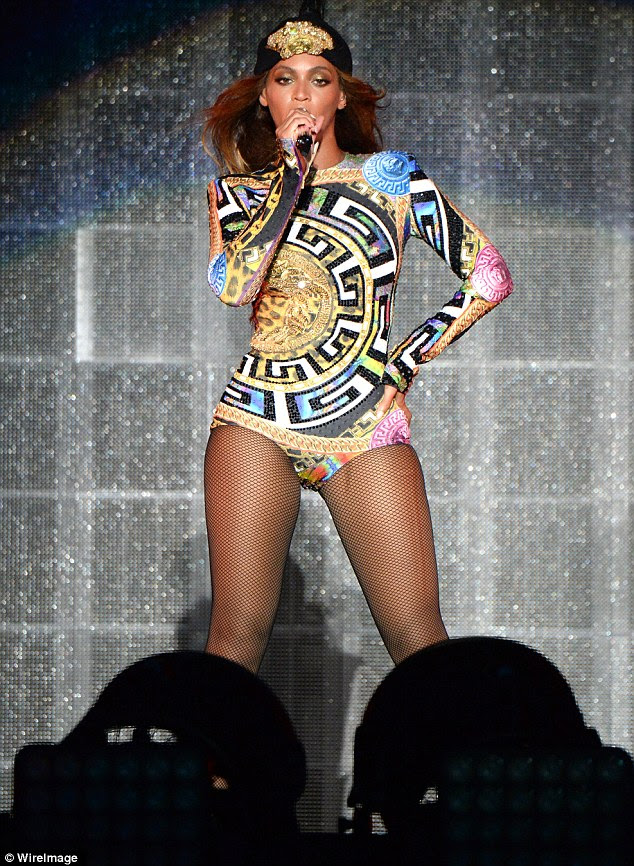 Eye-catching: She wore a brightly coloured leotard featuring elaborate designs