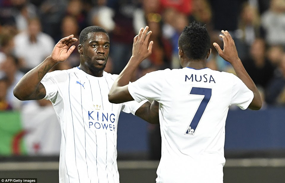 Nigerian international Ahmed Musa is congratulated by Jeffrey Schlupp after scoring his second goal of the night