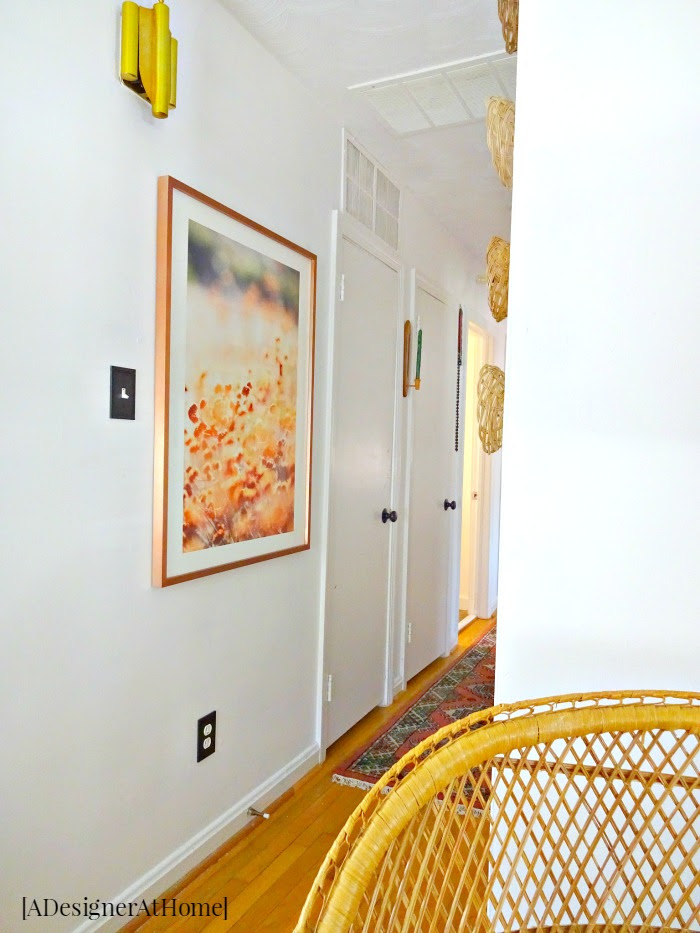 rounding the corner from an eclectic vintage bohemian living room to go down the newly decorated to match hallway