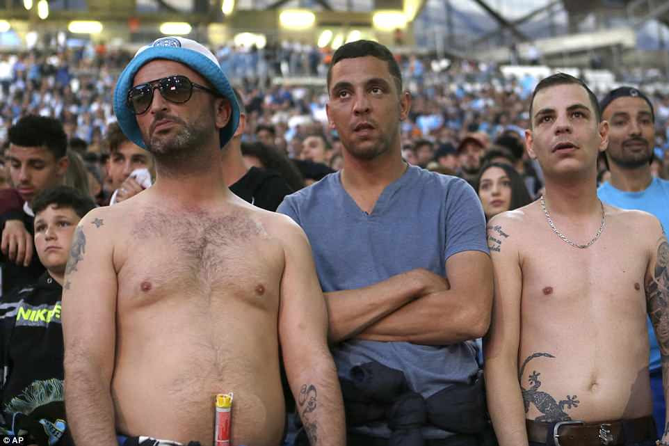 Marseille fans are silenced after seeing their side fall behind in the Europa League final at the Stade de Lyon on Wednesday
