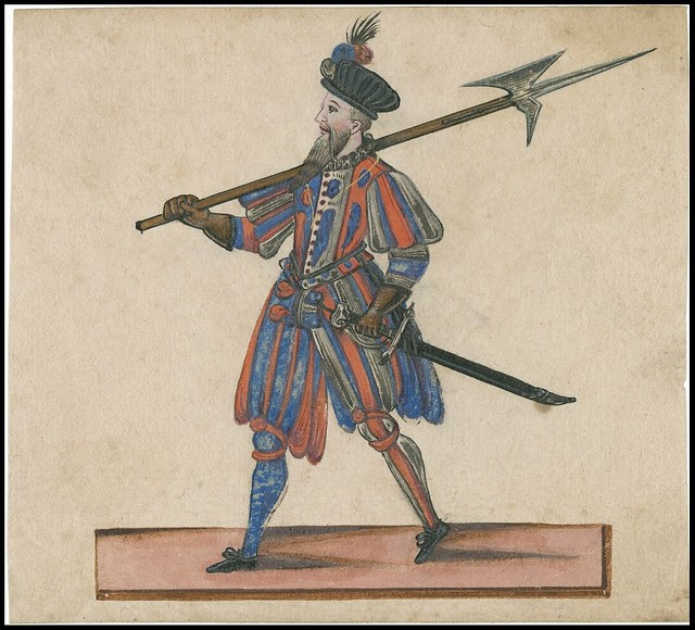 uniformed walking Jacobean sentry or soldier, pike-axe on shoulder, sword in belt