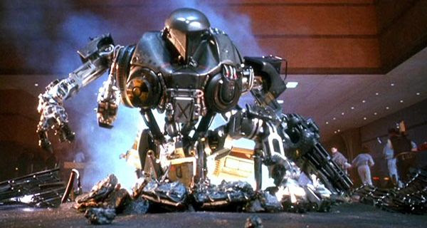 Cain wreaks havoc inside an auditorium in ROBOCOP 2.